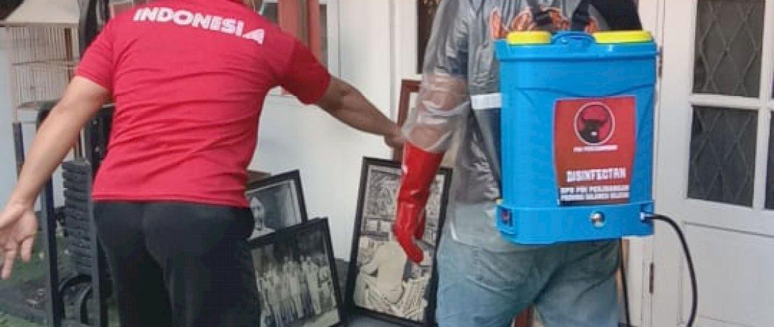 Tim Baguna PDIP Sulsel turun melakukan penyemprotan disinfektan.