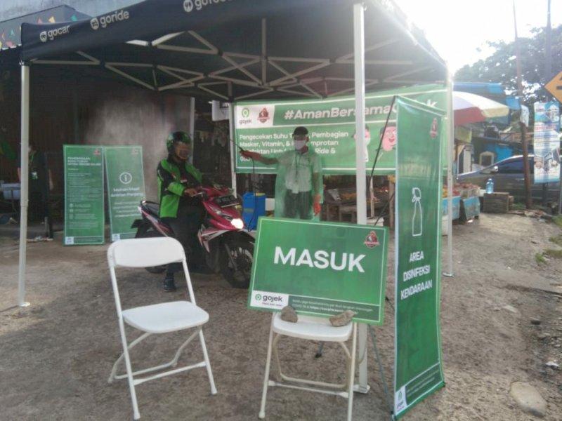 Driver Gojek di Makassar Diberi Masker dan Disemprot Disinfektan Setiap Hari